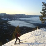 Dave skinning up with the fog of Lake Tahoe in the background