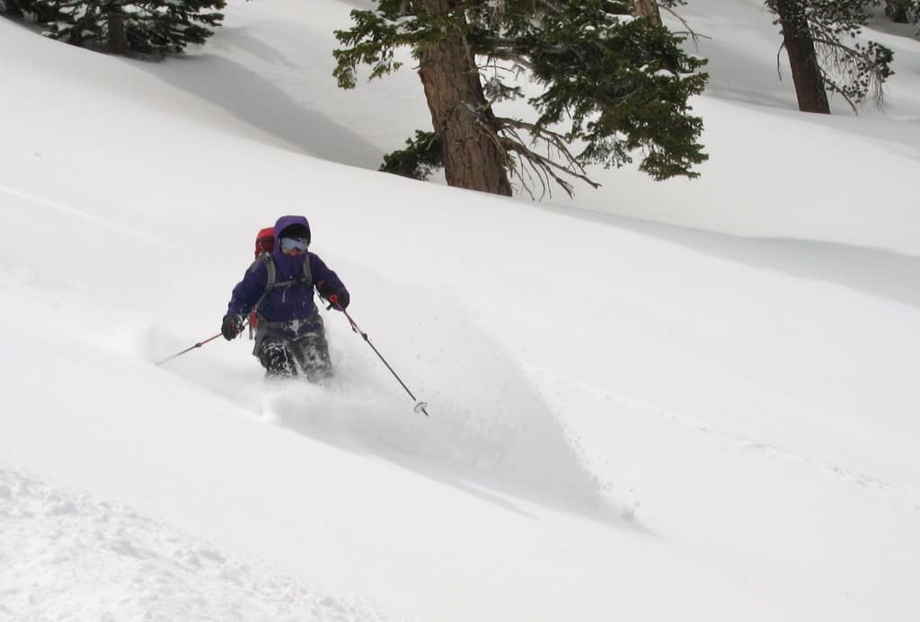 Pam skiing the backcountry powder