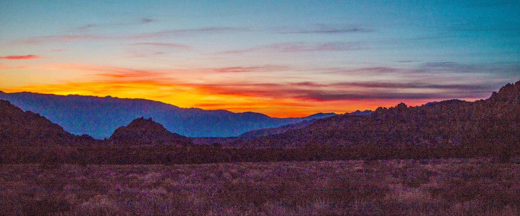 Sun rising over the White Mountains in the East