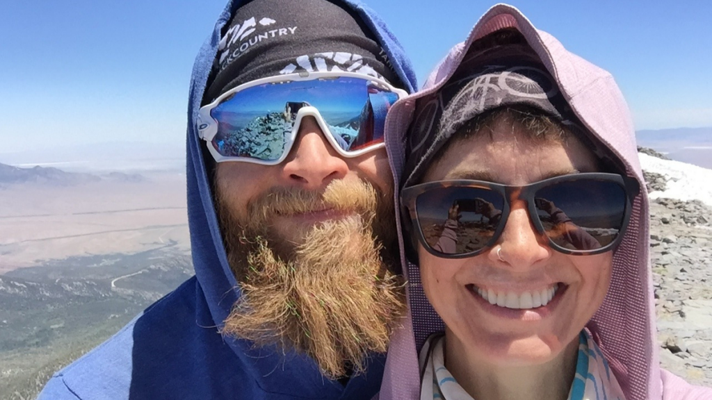 Coral and Chris smiling at the summit of Wheeler Peak.