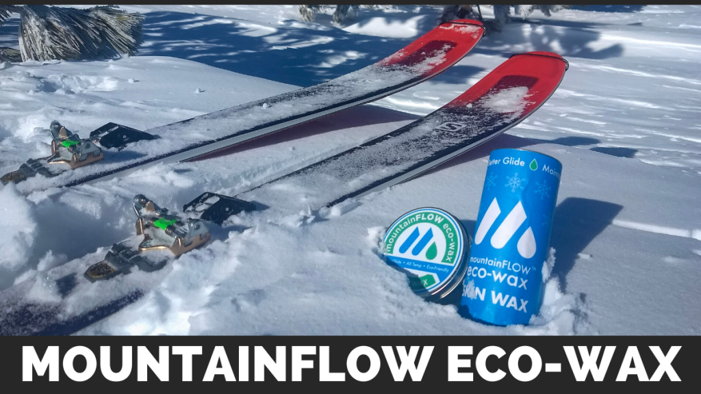 Backcountry skis next to two mountainFLOW eco-wax products in the snow.