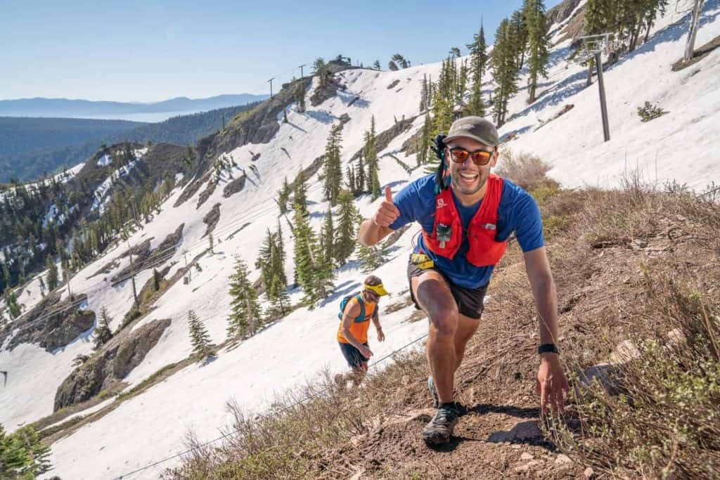 Runner climbing up a snow slope at the Broken Arrow Skyrace