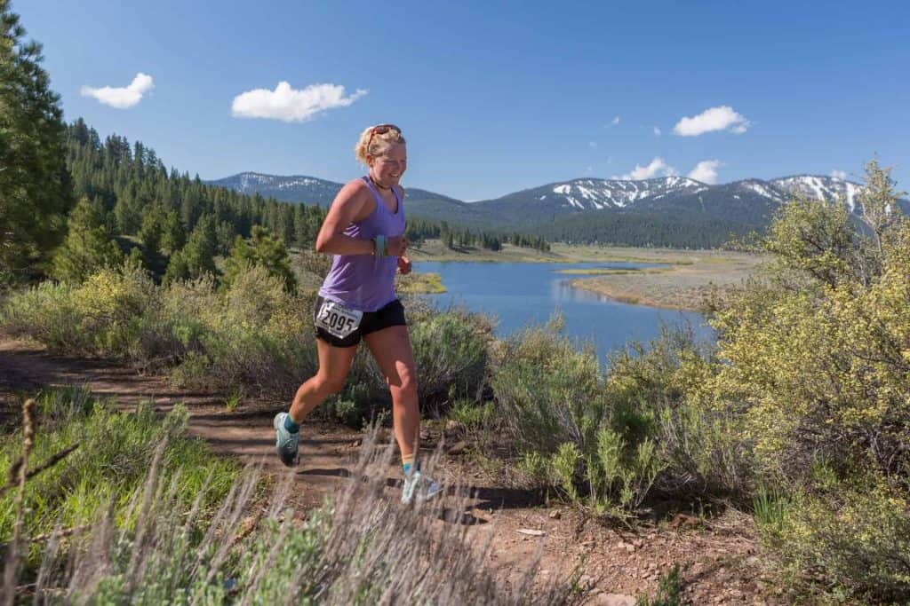 Runner on a trail at the Truckee Running Festival. Northstar California in the background.