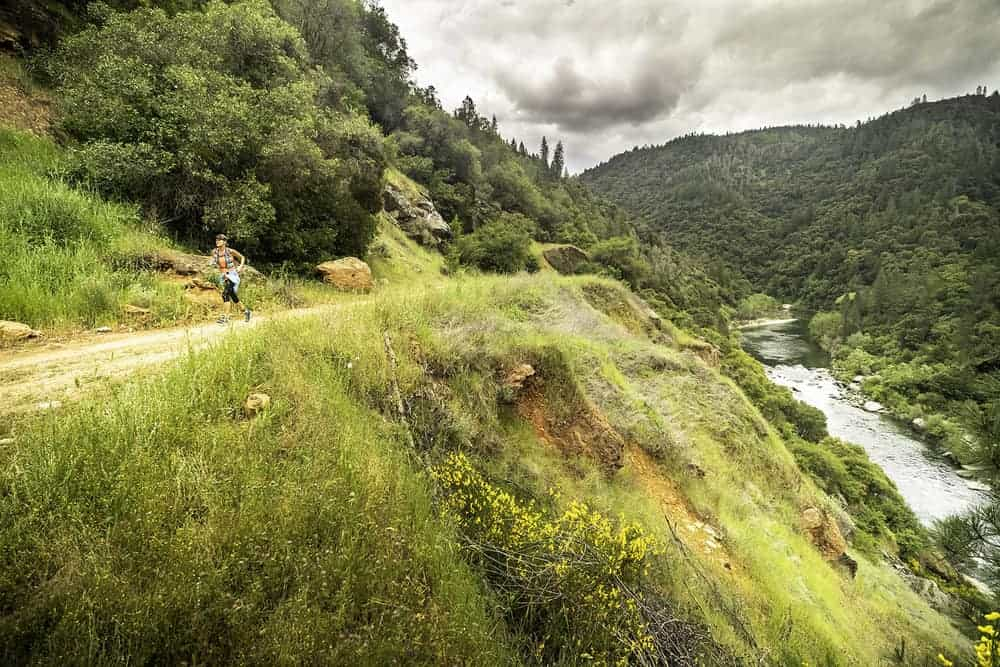 A trail runner on the Canyons Endurance Runs course